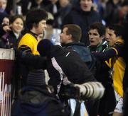 25 February 2006; QUB manager James McCartan squares up to DCU's Brendan Egan. Datapac Sigerson Cup Final, Queens University, Belfast v Dublin City University, Parnell Park, Dublin. Picture credit: Damien Eagers / SPORTSFILE