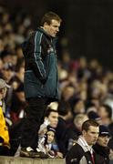 25 February 2006; QUB manager James McCartan stands on a wall next to the pitch after he was send off by referee Mick Monaghan. Datapac Sigerson Cup Final, Queens University, Belfast v Dublin City University, Parnell Park, Dublin. Picture credit: Damien Eagers / SPORTSFILE