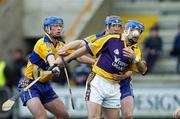 26 February 2006; Michael Jordan, Wexford, is tackled by Tommy Holland, left, and Conor Harrison, Clare. Allianz National Hurling League, Division 1A, Round 2, Wexford v Clare, Wexford Park, Wexford. Picture credit: Matt Browne / SPORTSFILE