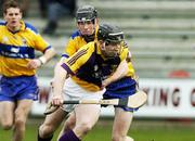 26 February 2006; Michael Jordan, Wexford, is tackled by Patrick Donnellan, Clare. Allianz National Hurling League, Division 1A, Round 2, Wexford v Clare, Wexford Park, Wexford. Picture credit: Matt Browne / SPORTSFILE