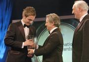 26 February 2006; Kevin Doyle, of Reading, is presented with the Under 21 International Player of the Year, by Dr Philip Nolan, Chief Executive, eircom, in the company of David Blood, President FAI, at the 16th eircom / FAI International Soccer Awards. Citywest Hotel, Dublin. Picture credit: David Maher / SPORTSFILE