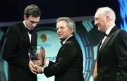 26 February 2006; George O'Callaghan, of Cork City, receives the eircom League Player of the Year from Dr Philip Nolan, Chief Executive, eircom, in the company of David Blood, President, FAI, at the 16th eircom / FAI International Soccer Awards. Citywest Hotel, Dublin. Picture credit: David Maher / SPORTSFILE