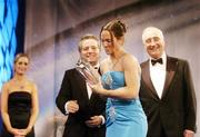 26 February 2006; Michelle O'Brien, of Long Island Lady Riders FC, New York, receives the Women's International Player of the Year from Dr Philip Nolan, left, Chief Executive, eircom, and David Blood, President, FAI, at the 16th eircom / FAI International Soccer Awards. Citywest Hotel, Dublin. Picture credit: David Maher / SPORTSFILE