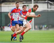 4 May 2014; Seamus O'Shea, Mayo, in action against Niall Farrell and Brendan Quigley, left, New York. Connacht GAA Football Senior Championship Preliminary Round, New York v Mayo, Gaelic Park, Bronx, New York, USA. Picture credit: Pat Murphy / SPORTSFILE