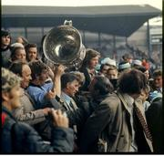 22 September 1974; The Dublin captain Sean Doherty makes his way down the Hogan Stand with the  Sam Maguire Cup. All Ireland Senior Football Championship Final, Dublin v Galway. Croke Park, Dublin. Picture credit: Connolly Collection / SPORTSFILE