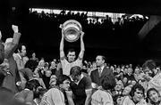 26 September 1976; The Dublin captain Tony Hanahoe lifts the Sam Maguire Cup alongside Uachtarán Chumann Lúthchleas Gael Con Murphy. All-Ireland Football Final, Dublin v Kerry, Croke Park, Dublin. Picture credit: Connolly Collection / SPORTSFILE