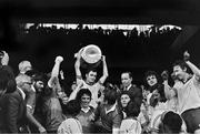 26 September 1976; The Dublin captain Tony Hanahoe lifts the Sam Maguire Cup alongside Uachtarán Chumann Lúthchleas Gael Con Murphy and team-mates Kevin Moran and Anton O'Toole. All-Ireland Football Final, Dublin v Kerry, Croke Park, Dublin. Picture credit: Connolly Collection / SPORTSFILE