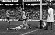 26 September 1976; Dublin's Brian Mullins celebrates after scoring his side's goal past Kerry goalkeeper Charlie Neligan. All-Ireland Football Final, Dublin v Kerry, Croke Park, Dublin. Picture credit: Connolly Collection / SPORTSFILE