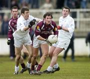 12 March 2006; Diarmuid Blake, Galway, in action against John Doyle, left and Padraig O'Neill, Kildare. Allianz National Football League, Division 1B, Round 4, Kildare v Galway, St. Conleth's Park, Newbridge, Co. Kildare. Picture credit: Pat Murphy / SPORTSFILE