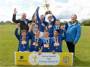13 May 2014; Alan Kavanagh, left, Aviva, and Nixon Morton, right, FAI Schools Executive, with winners of the Boy's C section, Bishop Foley Memorial School, Carlow. Aviva Health FAI Primary School 5's Leinster Finals, MDL Grounds, Navan, Co. Meath. Picture credit: Paul Mohan / SPORTSFILE