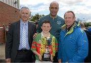 13 May 2014; Alan Kavanagh, left, Aviva, Paul Osam, FAI, and Nixon Morton, right, FAI Schools Executive, with James Clarke, captain of  Killoyn National School, Co. Meath, winners of the Boy's A section. Aviva Health FAI Primary School 5's Leinster Finals, MDL Grounds, Navan, Co. Meath. Picture credit: Paul Mohan / SPORTSFILE