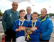 13 May 2014; Paul Osam, left, FAI, Alan Kavanagh, Aviva, and Nixon Morton, right, FAI Schools Executive, with Ben Dorley and James Esser, joint captains of  Bishop Foley National School, Co. Carlow, winners of the Boy's C section. Aviva Health FAI Primary School 5's Leinster Finals, MDL Grounds, Navan, Co. Meath. Picture credit: Paul Mohan / SPORTSFILE