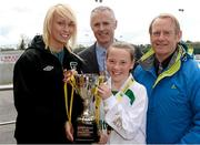 13 May 2014; Republic of Ireland international footballer Stephanie Roche, FAI, Alan Kavanagh, Aviva, and Nixon Morton, right, FAI Schools Executive, with Clodagh Dillon, captain of  Milltown National School, Co. Westmeath, winners of the Girl's A section. Aviva Health FAI Primary School 5's Leinster Finals, MDL Grounds, Navan, Co. Meath. Picture credit: Paul Mohan / SPORTSFILE