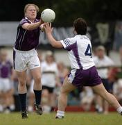 18 March 2006; Claire Egan, Mayo, 2004 O'Neills / TG4 Ladies GAA All-Stars, is tackled by Leona Egan Tector, Wexford, 2005 O'Neills / TG4 Ladies GAA All-Stars. Singapore Polo Club, Singapore. Picture credit: Ray McManus / SPORTSFILE