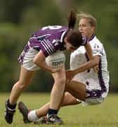 18 March 2006; Annette Clarke, 2004 O'Neills / TG4 Ladies GAA All-Stars, is tackled by Mary Roche - Barry, 2005 O'Neills / TG4 Ladies GAA All-Stars. Singapore Polo Club, Singapore. Picture credit: Ray McManus / SPORTSFILE