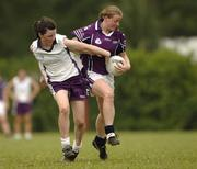 18 March 2006; Mary Nevin, Dublin, 2004 O'Neills / TG4 Ladies GAA All-Stars, is tackled by Lyndsay Davey, Dublin, 2005 O'Neills / TG4 Ladies GAA All-Stars. Singapore Polo Club, Singapore. Picture credit: Ray McManus / SPORTSFILE