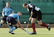 19 March 2006; Paul Lombard, Cork Harlequins, in action against Ian Davidson, Lisnagarvey. Irish Men's Senior Cup Final, Cork Harlequins v Lisnagarvey, Belfield, UCD, Dublin. Picture credit: Ciara Lyster / SPORTSFILE