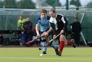 19 March 2006; David Egner, Cork Harlequins, in action against Jonathan Bloomfield, Lisnagarvey. Irish Men's Senior Cup Final, Cork Harlequins v Lisnagarvey, Belfield, UCD, Dublin. Picture credit: Ciara Lyster / SPORTSFILE