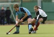 19 March 2006; Mark Robinson, Lisnagarvey, in action against Paul Lombard, Cork Harlequins. Irish Men's Senior Cup Final, Cork Harlequins v Lisnagarvey, Belfield, UCD, Dublin. Picture credit: Ciara Lyster / SPORTSFILE