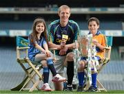 15 May 2014; The Brightest Stars of hurling came together in Croke Park today to mark Centra's fifth year as official sponsor of the GAA Hurling All-Ireland Senior Championship. The talented trio of Henry Shefflin, Patrick Horgan and Padraic Maher were all on hand as Centra announced their community hurling events will be taking place in stadiums and clubs the length and breadth of the country this summer. Centra will also be on the hunt for Ireland's Brightest Young Star to get the views and opinions of today's young players and the child with the brightest answers will be crowned Centra's Brightest Young Star! For more information on the community events go to www.centra.ie or find Centra Ireland on Facebook and Twitter. At the Centra announcement in Croke Park are Kilkenny hurler Henry Shefflin with Isabella Crinion, age 8, and Evan Wilkes, age 10. Picture credit: Stephen McCarthy / SPORTSFILE