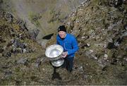 16 May 2014; Kerry's Seamus Moynihan, bringing the Sam Maguire Cup on the Summit of Carrauntoohil, MacGillycuddy's Reeks, Co Kerry, in a the unique event 'Sam to Summit' in aid of the Alan Kerins Projects which saw Sam Maguire and representatives and players with All Ireland football medals from each of the 32 counties reach the top of Ireland's highest mountain. Picture credit: Valerie O'Sullivan / SPORTSFILE