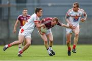 17 May 2014; Damian Dolan, Westmeath, in action against Andy McDonnell, left, and Paddy Keenan, Louth. Leinster GAA Football Senior Championship, Round 1, Westmeath v Louth, Cusack Park, Mullingar, Co. Westmeath. Picture credit: Paul Mohan / SPORTSFILE