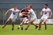 17 May 2014; Damian Dolan, Westmeath, in action against Andy McDonnell, left, Paddy Keenan and Derek Crilly, right, Louth. Leinster GAA Football Senior Championship, Round 1, Westmeath v Louth, Cusack Park, Mullingar, Co. Westmeath. Picture credit: Paul Mohan / SPORTSFILE