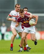 17 May 2014; John Heslin, Westmeath, in action against Paddy Keenan, Louth. Leinster GAA Football Senior Championship, Round 1, Westmeath v Louth, Cusack Park, Mullingar, Co. Westmeath. Picture credit: Paul Mohan / SPORTSFILE