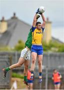 18 May 2014; Donie Shine, Roscommon, in action against Donal Wrynn, Leitrim. Connacht GAA Football Senior Championship Quarter-Final, Roscommon v Leitrim, Dr. Hyde Park, Roscommon. Picture credit: Barry Cregg / SPORTSFILE