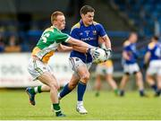18 May 2014; Shane Mulligan, Longford, in action against Peter Cunningham, Offaly. Leinster GAA Football Senior Championship Round 1, Longford v Offaly, Pearse Park, Longford. Picture credit: Paul Mohan / SPORTSFILE