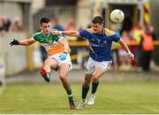 18 May 2014; Eoin Carroll, Offaly, in action against Shane Mulligan, Longford. Leinster GAA Football Senior Championship Round 1, Longford v Offaly, Pearse Park, Longford. Picture credit: Paul Mohan / SPORTSFILE