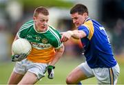 18 May 2014; Peter Cunningham, Offaly, in action against Shane Mulligan, Longford. Leinster GAA Football Senior Championship Round 1, Longford v Offaly, Pearse Park, Longford. Picture credit: Paul Mohan / SPORTSFILE