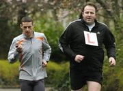 28 March 2006; Team coach Gary Crossan keeps an eye on former Cork star Colin Corkery, who has signed up for the 2006 adidas Dublin Marathon Virgins team. Corkery is looking for 12 other first time marathon runners from around the country to join him on the team. People can sign up at www.adidasdublinmarathon.ie. Merrion Square, Dublin. Picture credit: Ciara Lyster / SPORTSFILE