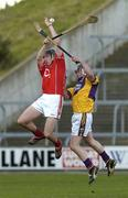 2 April 2006; John Gardiner, Cork, in action against Darren Stamp, Wexford. Allianz National Hurling League, Division 1A, Round 4, Wexford v Cork, Wexford Park, Wexford. Picture credit: Pat Murphy / SPORTSFILE