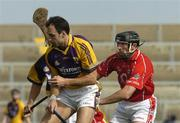 2 April 2006; Darragh Ryan, Wexford, in action against Brian Corcoran, Cork. Allianz National Hurling League, Division 1A, Round 4, Wexford v Cork, Wexford Park, Wexford. Picture credit: Pat Murphy / SPORTSFILE