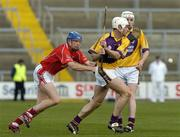 2 April 2006; Declan Ruth, Wexford, in action against Ciaran McGann, Cork. Allianz National Hurling League, Division 1A, Round 4, Wexford v Cork, Wexford Park, Wexford. Picture credit: Pat Murphy / SPORTSFILE