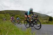 22 May 2014; Tom Scully, Madison Gensis, on a descent to Glengarriff, Co. Cork, during Stage 5 of the 2014 An Post Rás. Cahirciveen - Clonakilty. Picture credit: Ramsey Cardy / SPORTSFILE