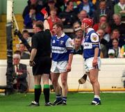 20 June 1999; Cyril Cuddy of Laois is shown a red card by referee Michael Wadding during the Guinness Leinster Senior Hurling Championship Semi-Final match between Kilkenny and Laois at Croke Park in Dublin. Photo by Ray McManus/Sportsfile