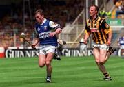 20 June 1999; Cyril Cuddy of Laois in action against Andy Comerford of Kilkenny during the Guinness Leinster Senior Hurling Championship Semi-Final match between Kilkenny and Laois at Croke Park in Dublin. Photo by Aoife Rice/Sportsfile