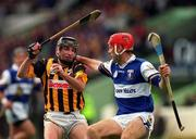 20 June 1999; DJ Carey of Kilkenny in action against Bill Maher of Laois during the Guinness Leinster Senior Hurling Championship Semi-Final match between Kilkenny and Laois at Croke Park in Dublin. Photo by Ray McManus/Sportsfile