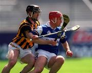 20 June 1999; David Cuddy of Laois in action against Denis Byrne of Kilkenny during the Guinness Leinster Senior Hurling Championship Semi-Final match between Kilkenny and Laois at Croke Park in Dublin. Photo by Ray McManus/Sportsfile