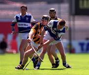 20 June 1999; Denis Byrne of Kilkenny is tackled by David Cuddy of Laois during the Guinness Leinster Senior Hurling Championship Semi-Final match between Kilkenny and Laois at Croke Park in Dublin. Photo by Ray McManus/Sportsfile