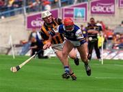 20 June 1999; Fionán O'Sullivan of Laois in action against Tom Hickey of Kilkenny during the Guinness Leinster Senior Hurling Championship Semi-Final match between Kilkenny and Laois at Croke Park in Dublin. Photo by Aoife Rice/Sportsfile