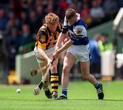 20 June 1999; Donal Russell of Laois in action against John Power of Kilkenny during the Guinness Leinster Senior Hurling Championship Semi-Final match between Kilkenny and Laois at Croke Park in Dublin. Photo by Ray McManus/Sportsfile