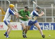 16 April 2006; Mark Keane, Limerick, in action against Eoin Murphy, left, and Tom Feeney, Waterford. Allianz National Hurling League, Division 1 Quarter-Final, Waterford v Limerick, Semple Stadium, Thurles, Co. Tipperary. Picture credit: Brian Lawless / SPORTSFILE