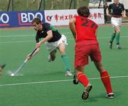 15 April 2006; Ireland's John Jermyn, Cork Church of Ireland, on the attack against Belgium in the third pool match. Belgium won the match 1-0. Ireland now need to beat Egypt on Monday in their next pool match to keep their qualifying hopes alive. BDO Men's Hockey World Cup Qualifier, Pool A, Ireland v Belgium, Changzhou, China. Issued on behalf of the Irish Sports Council by SPORTSFILE