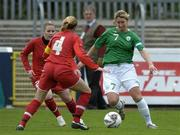 22 April 2006; Ciara Grant, Republic of Ireland, in action against Prisca Steinegger (4) and Daniela Kuenzler, Switzerland.  World Cup Qualifier, Republic of Ireland v Switzerland, Richmond Park, Dublin. Picture credit: Ray Lohan / SPORTSFILE