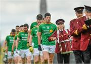 18 May 2014; Leitrim captain Emlyn Mulligan leads his side in the pre-match parade. Connacht GAA Football Senior Championship Quarter-Final, Roscommon v Leitrim, Dr. Hyde Park, Roscommon. Picture credit: Piaras Ó Mídheach / SPORTSFILE