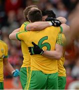 25 May 2014; Dermot Molloy, Leo McLoone and David Walsh, Donegal, embrace at the final whistle. Ulster GAA Football Senior Championship Quarter-Final, Derry v Donegal, Celtic Park, Derry. Picture credit: Oliver McVeigh / SPORTSFILE