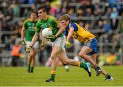 18 May 2014; Paddy Maguire, Leitrim, in action against Ronan Stack, Roscommon. Connacht GAA Football Senior Championship Quarter-Final, Roscommon v Leitrim, Dr. Hyde Park, Roscommon. Picture credit: Piaras Ó Mídheach / SPORTSFILE